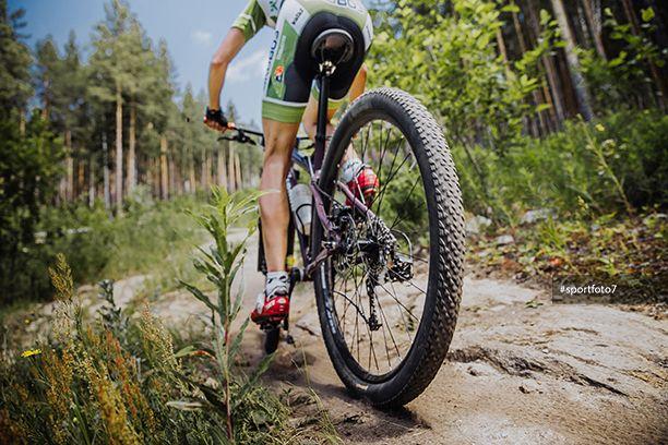 male athlete cyclist riding a bike