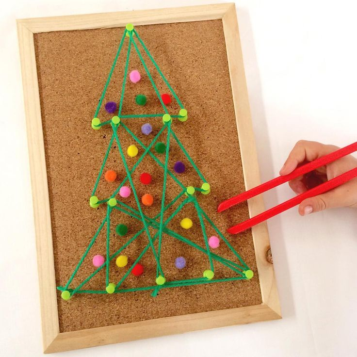 CHRISTMAS TREE GEOBOARD    we put together this geometric Christmas tree today using a cork board, push pins and yarn We decorated the tree with pom poms and then used our fine motor skills to remove the decorations with tweezers. We have played this game quite a few times and it has been well loved by miss5 each time.