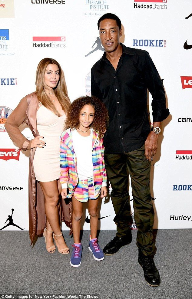 With one of their four children: Larsa and Scottie with Sophia in September...