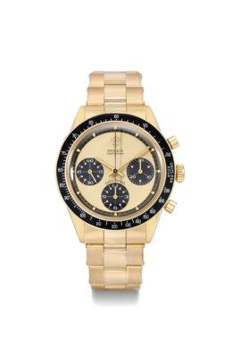 Rolex. An extremely rare and highly attractive 18K gold chronograph wristwatch with champagne dial and white numerals inside the subsidiary dials SIGNED ROLEX, COSMOGRAPH, DAYTONA, PAUL NEWMAN MODEL, REF. 6264, CASE NO. 2'357'468, CIRCA 1970 Price realised CHF 387,750 Estimate CHF 150,000 - CHF 250,000