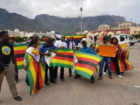 This, as numerous other similar marches are taking place across the country today - where hundreds of Zimbabweans living in South Africa have gathered to support efforts to remove the 93-year-old from power - following a takeover by the military earlier this week. #zimbabwe #capetown #southafrica