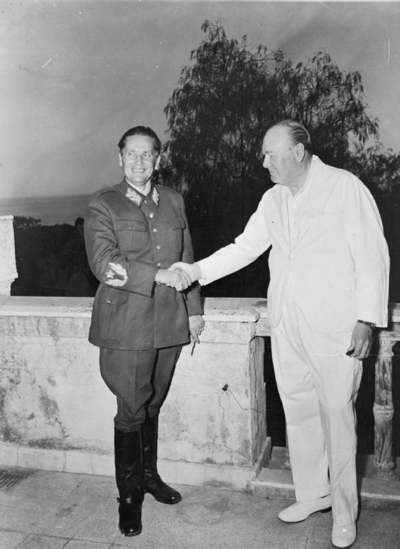 Winston Churchill shakes hands with Yugoslavia's Marshal Tito.