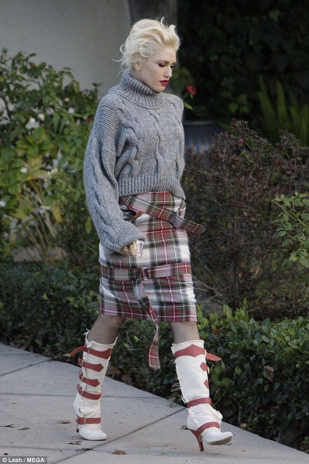 So cool: Gwen channelled a punk look with her tartan bondage skirt by the British designer...