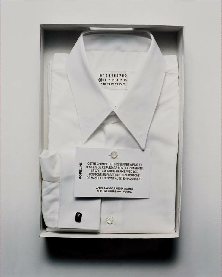 # Archives # Autumn-Winter 2002 - Maison Martin Margiela Menswear Shirt description & care instructions  With our Autumn-Winter 2014 Menswear show coming up, no time for ironing but we hang to dry. This cotton Poplin shirt from 2002 with a removable collar, plastic buttons and plastic cufflinks comes with permanent iron folds.