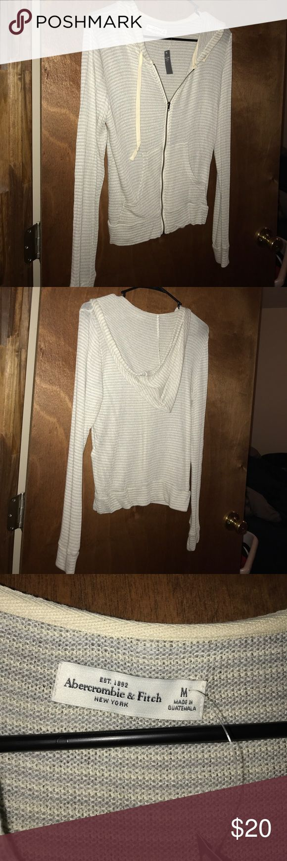 Gray and white striped zip up sweatshirt. long sleeved gray and white striped Abercrombie and Fitch hooded zip up. Very light. Never worn. Abercrombie & Fitch Tops Sweatshirts & Hoodies