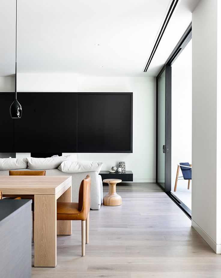 via Est Magazine... Lubelso Concept Home in Melbourne. The living area. The living areas are drenched in natural light thanks to the three metre high windows with the different living zones merging together as one large room. Architect: Mary-Ann Woff.