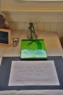 "Instead of a guest book, she had guests sign a personal message in ""The Giving Tree"" for a teacher retirement - how cool!"