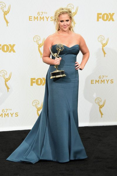 "Comedian Amy Schumer, winner of Outstanding Variety Sketch Series for ""Inside Amy Schumer"", poses in the press room at the 67th Annual Primetime Emmy Awards at Microsoft Theater on September 20, 2015 in Los Angeles, California."
