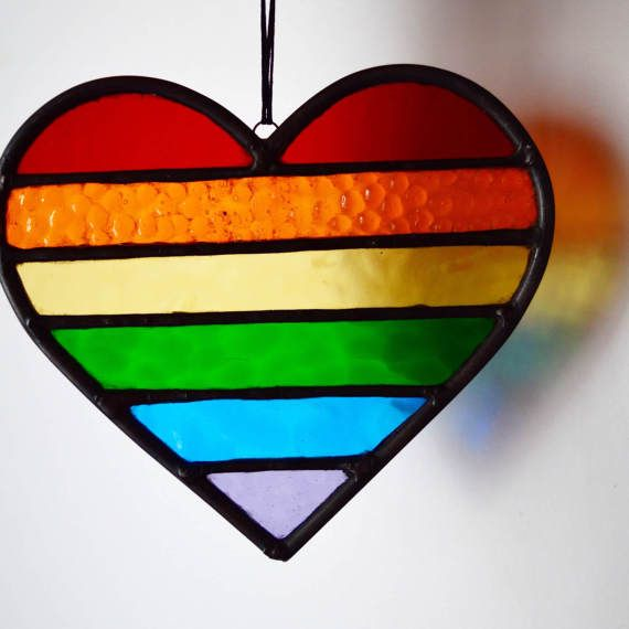 Stained glass rainbow heart. This heart shines so bright when back lit by the sun. A perfect sun catcher for your window.