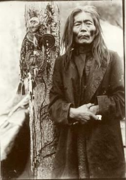 Evenk shaman with a collection of shamanic objects,   including images of helper spirits, early 1900s.   No. 5659-120
