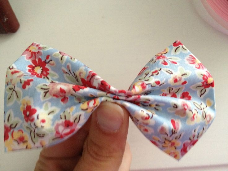 Here is  an easy little tutorial on how to make a cute bow out of fabric. You can use this little bow to embellish hairbands, clips, clothes  anything that takes your fancy! Firstly cut out a rectangle of fabric and fold over the top, bottom and sides and iron