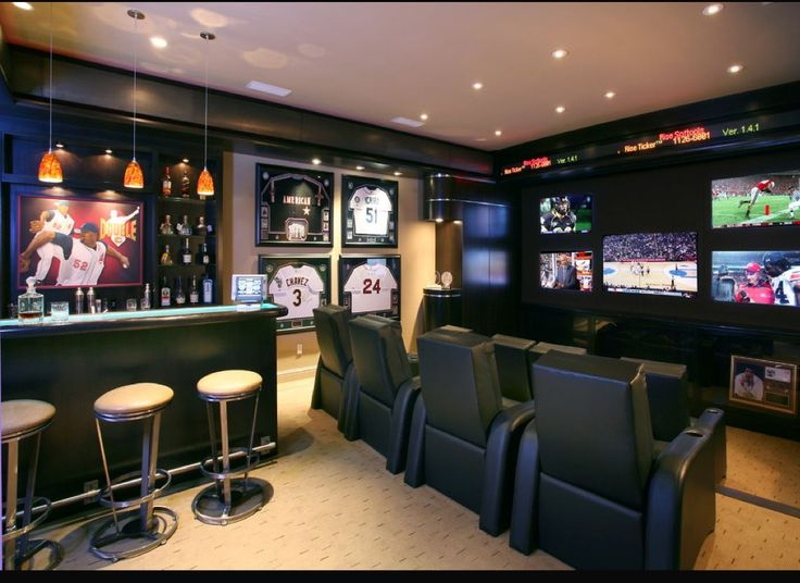 man cave basement Creating the perfect Sports Man Cave includes adding modern Work Benches for entertaining. A place where you build the room around the beer and potato chips Man Cave Designs, Best Man Caves, Home Theaters, Sports Man Cave, Football Man Cave, Football Jerseys, Man Cave Ideas Sports Theme, Hockey Man Cave, Sports Bar Decor