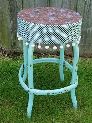 this reminds me of a stool in my grandpa's kitchen, not this embellished of course, it was my favorite spot to sit.