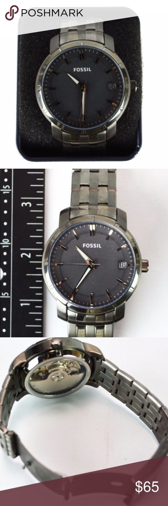 NWT Fossil Automatic Watch  Men's Fossil automatic watch.  Ion plated steel, gunmetal color with silver accents in the face. Includes the date. Never warn, tags still attached. Has few minor scratches but is in excellent condition! Authentic. No trades! Fossil Accessories Watches
