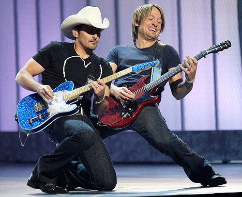 Brad Paisley and Keith Urban the best guitar players today! You gotta add Prince to that list too.