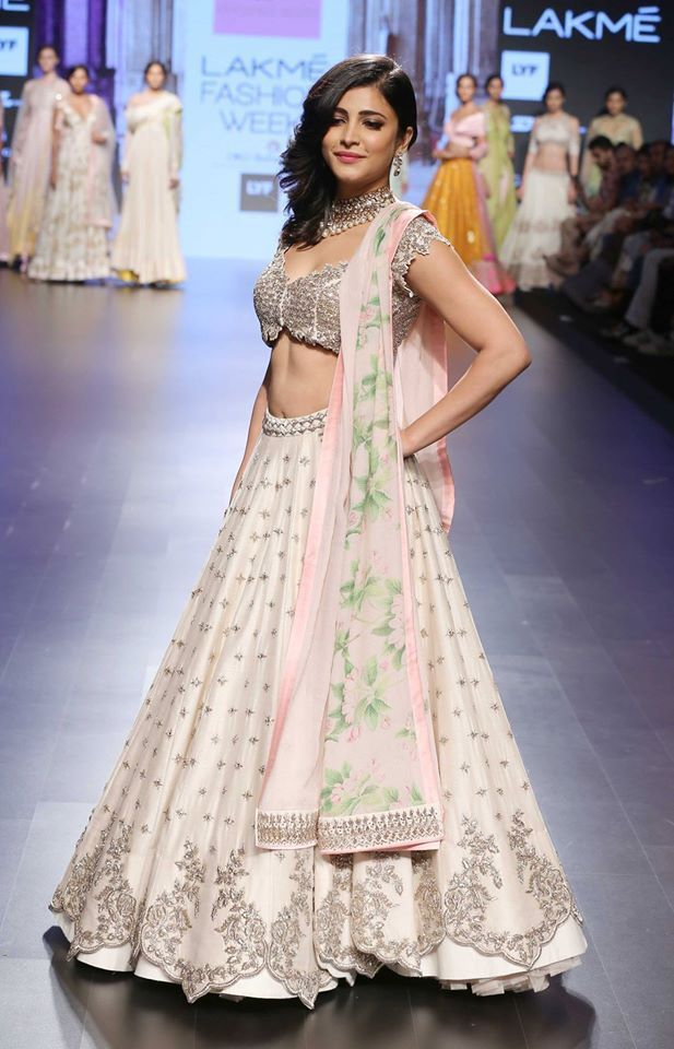 Shruti Hasan in ivory lehenga with scalloped handmade zardozi and floral pastel lily print dupatta by Anushree Reddy at Lakme Fashion Week Summer Resort 2016 side view - dress blouses for work, women's sheer blouses, black & white blouse *ad