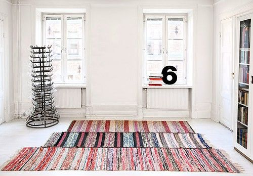 "Made from scraps of fabric and the most beutiful rugs. I it was up to me I would cover my floor with them, but its not only up to me so for the moment I need to be satisfied with ""trasmattor"" only in the bedroom."