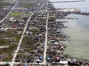 """WHO Calls Typhoon's Medical Challenges """"Monumental""""  An aerial image taken from a Philippine Air Force helicopter shows the devastation caused by Typhoon Haiyan in Guiuan."""