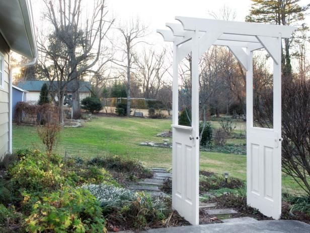 Build a charming entryway for your garden by upcycling a pair of old doors >> http://www.diynetwork.com/how-to/outdoors/hardscape/make-a-garden-arbor-from-old-wooden-doors?soc=pinterest