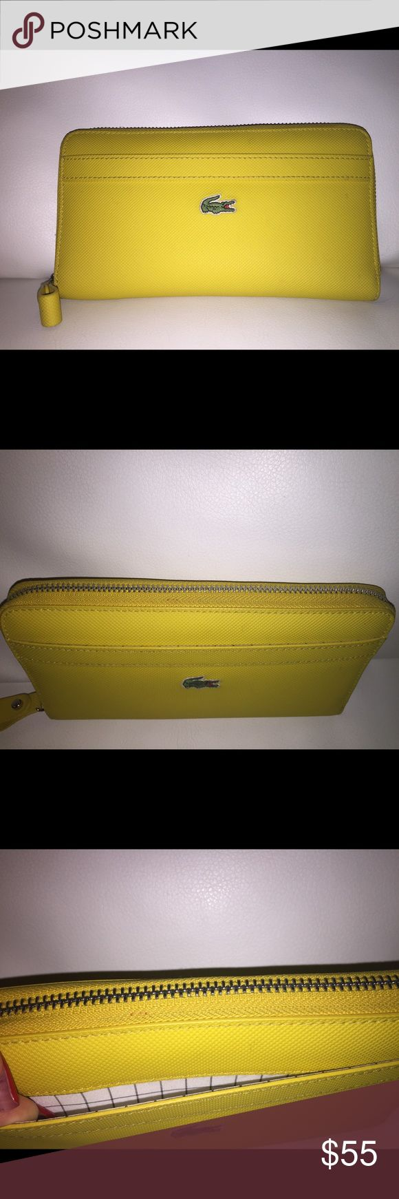 Lacoste continental zip yellow wallet Lacoste pvc continental zip wallet, gently used. So many compartments. Zipper functions properly. Miner specks as shown in pics. Six card slots, six flap compartments, one coin zip, exterior flap and comes with original box of purchase. Lacoste Bags Wallets
