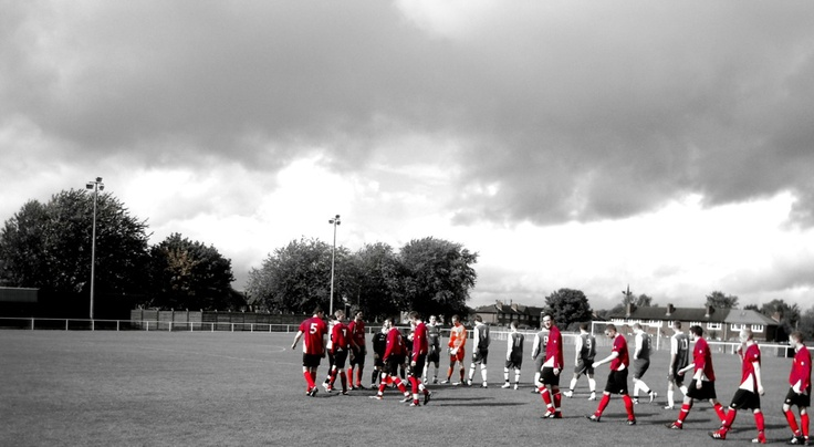 Away at Abbey Hey. The teams come out under a moody sky.