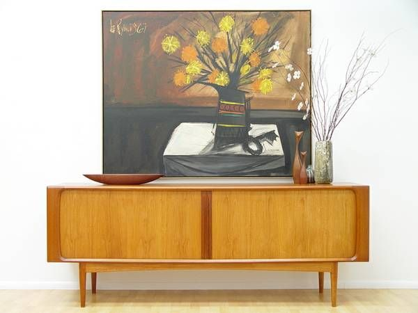 """craigslist, St. Petersburg, FL..Beautiful Teak Denmark Scandinavian Danish Modern Credenza / Sideboard with Tambour Sliding Doors adjustable center shelves  with 3 center drawers. Call 727-215-3239 Lee Reynolds Oil Painting Dated 1967 measures 61"""" Across by 49"""" Tall Lamp shown on Credenza 140.00 Credenza Measures Approx: 82 3/4"""" Long by 20"""" Deep - 31 3/4"""" Tall.."""