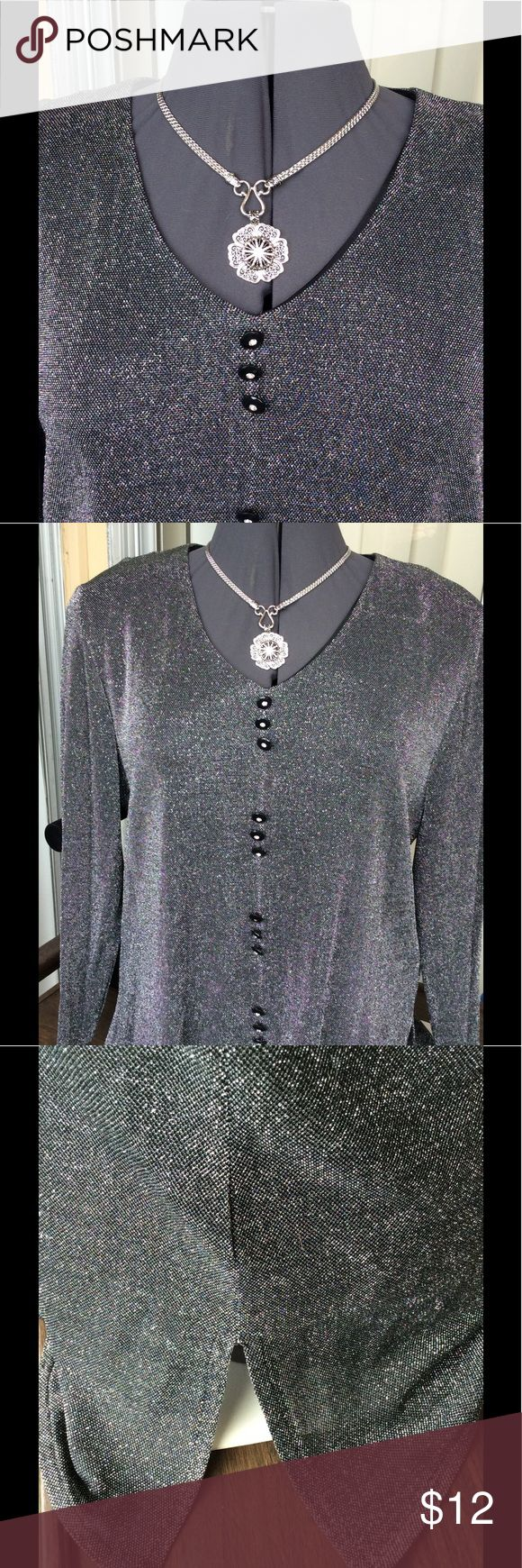 XL Black and silver blouse This long sleeve blouse is in excellent used condition. Black with silver shimmering thread. Best I can remember, it is an XL. Bust measures 44 between armpits. Side slits and slit in front. Casual yet dressy! Buttons with rhinestones ONE missing it. See last picture. Snap Necklace also for sale in my closet. Another Thyme Tops Blouses