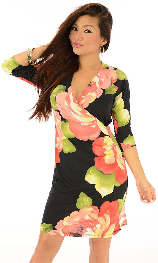 Ran-$21.80-Stand tall and accept your style accolades when you wear this festive dress. The cross-over front design has a lively floral print. The three quarter sleeves and soft to the touch fabric deliver a pleasing fit.