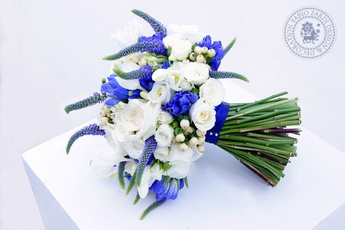 Luxury bridal bouquet with:      Rosa Avalanche     Rosa Akito     Rosa tros White Lady     Gentiana     Veronica     Hypericum     Bouvardia     Eucharis grandiflora