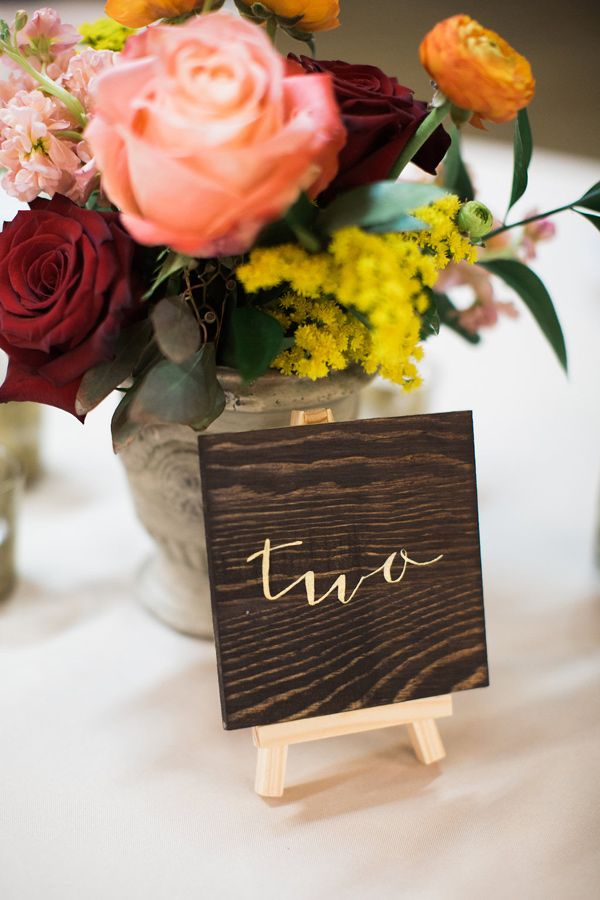 table numbers on easels - photo by Casto Photography http://ruffledblog.com/roma-red-wedding-inspiration-in-nashville