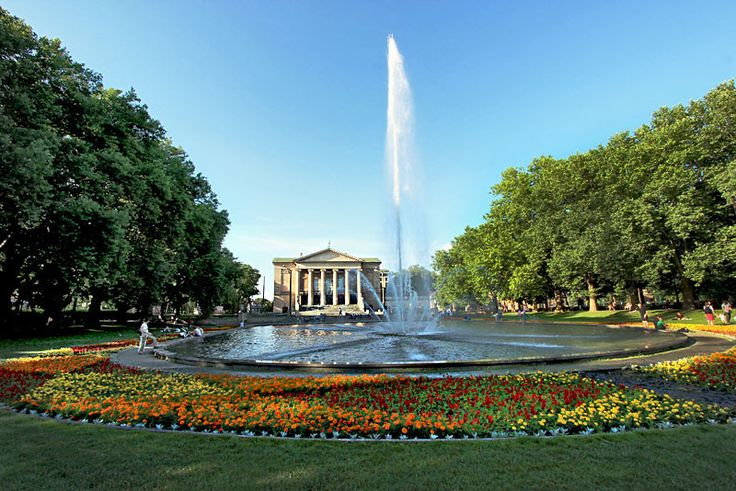 Park at the Great Theater (Opera House) is a favorite family gathering spot in Poznan, Poland