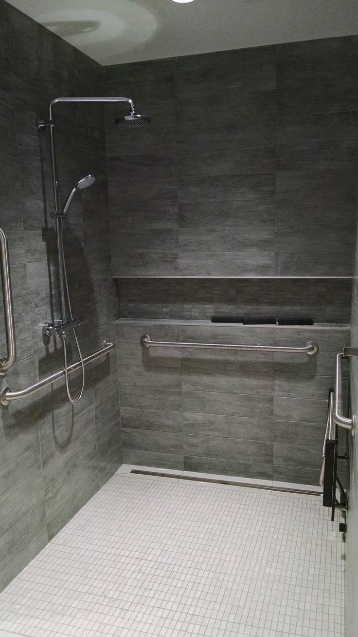 ADA Roll in shower. Grohe valve & tile covered linear drain. Converted from toilet stall.