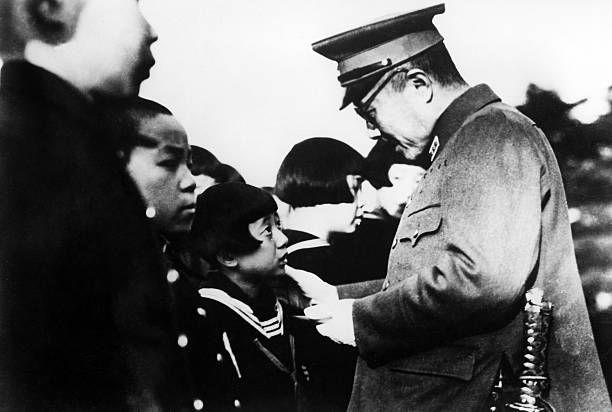 Tojo Hideki General Japan Tojo talking with children on a visit to Manchukuo 1943