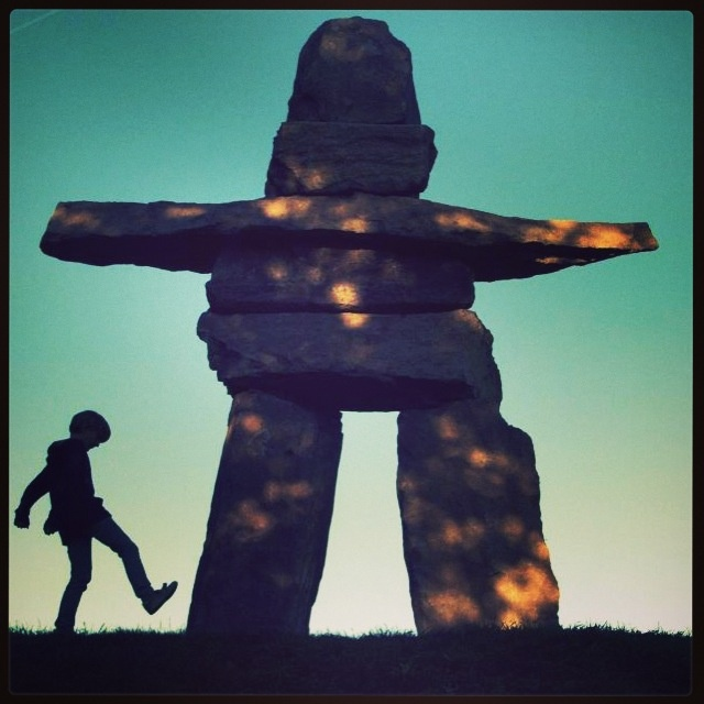 "The mysterious, usually stone figures known as inuksuit can be found throughout the arctic world. Inukshuk, the singular of inuksuit, means ""in the likeness of a human"" in the Inuit language, Inuktitut. They are monuments made of unworked stones that are used by the Inuit for communication and survival. The traditional meaning of the inukshuk is ""Someone was here"" or ""You are on the right path."" The Inuit make inuksuit in different forms for a variety of purposes: as navigation or…"