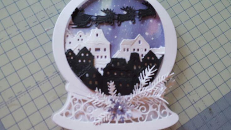 Tattered lace snow globe Santander card