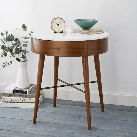 Surprised to find out this perfect little round nights tand is the Penelope Nightstand from West Elm. Not sure if you know, but it is extremely difficult to find a nice, round, well proportioned night stand WITH a drawer!