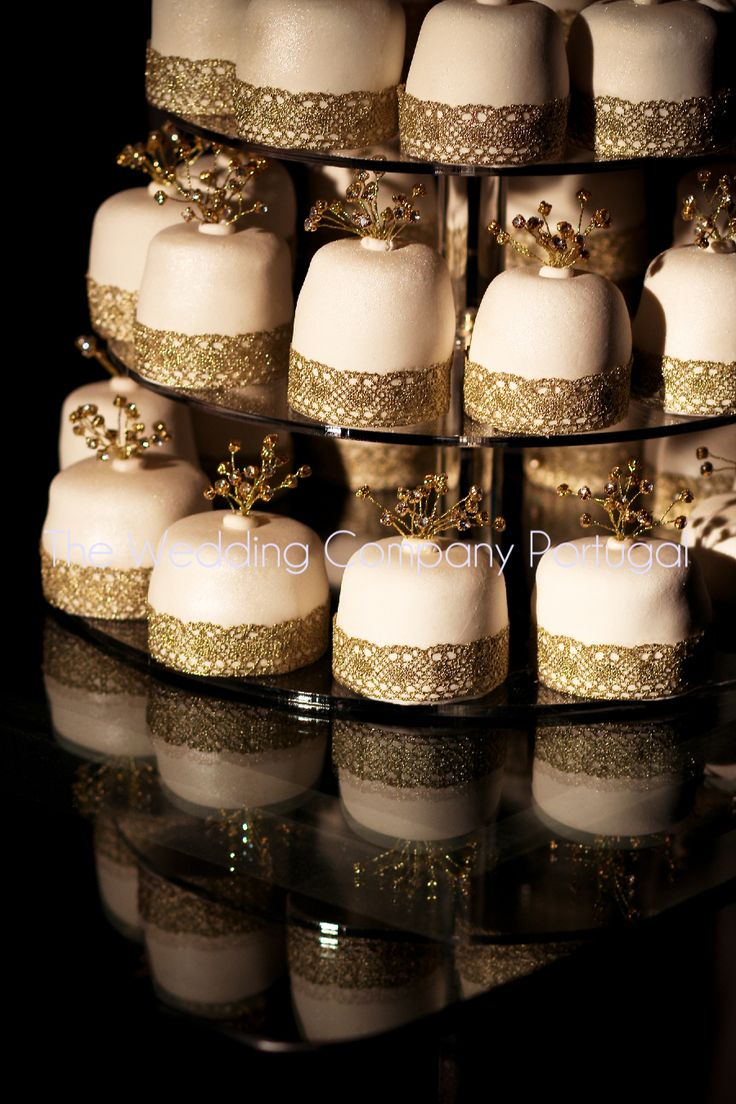 Gold & White Mini Ckes decorated with gold lace detail. Wedding by The Wedding Company.  Photo by Catarina Zimbarra Photography.