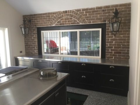 Black Kitchen Poly finish soft close drawers and stainless steel bench