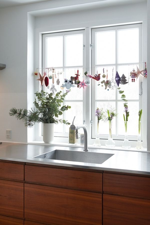 ornaments on a spring-loaded curtain rod in the kitchen window! Tips for Decorating a Small Space for the Holidays #theeverygirl