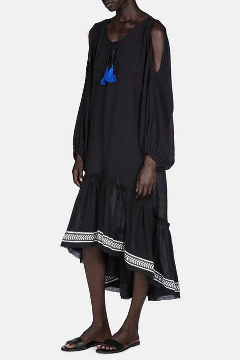 Lemlem is designer and model Liya Kebede's collection of luxuriously rustic womenswear. This lightweight cotton gauze dress is her fresh take on a shoulder-baring silhouette. The relaxed, dropped-waist silhouette is accented by handwoven chevron trim at the draped hem, which dips lower in back. Framed by a tassel-trimmed keyhole neckline, the unstructured cut and billowing sleeves allow for ultimate comfort and ease of movement.