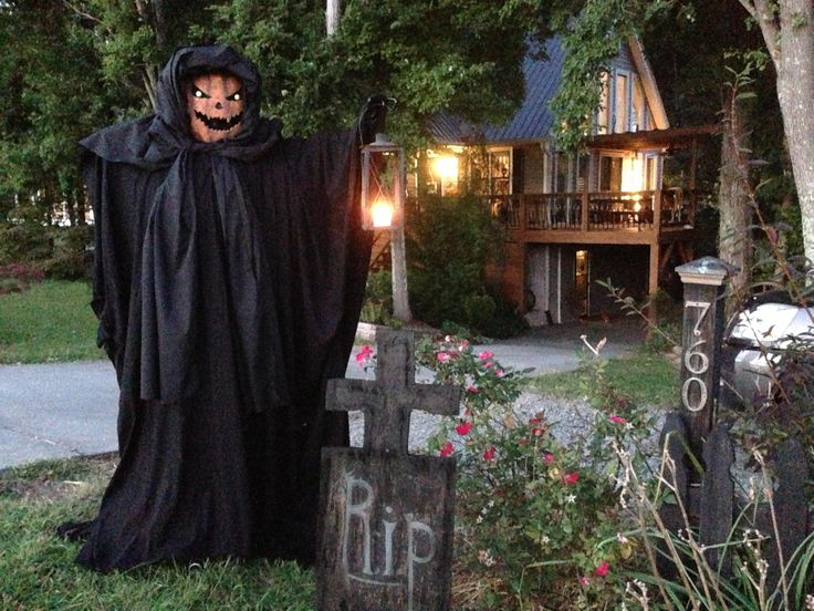 decorating creepy halloween outdoor decorations with scarecrow in black robe and pumpkin head also gravestone
