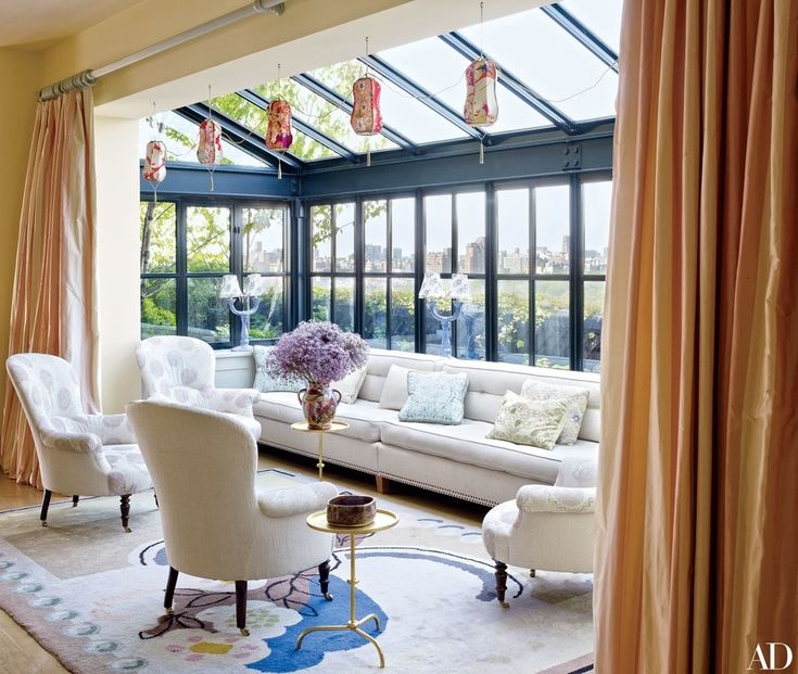 Lanterns made from vintage kimonos jazz up the main-floor alcove Midler calls the sunroom. The armchairs (one is Napoléon III, the others are custom-made reproductions) are clad in a hand-stenciled fabric by Off-White Castle Studio.