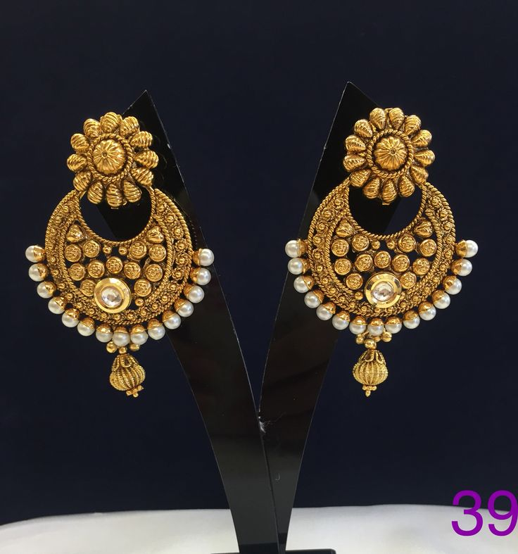 Gold plated earring with mundane and pearl.