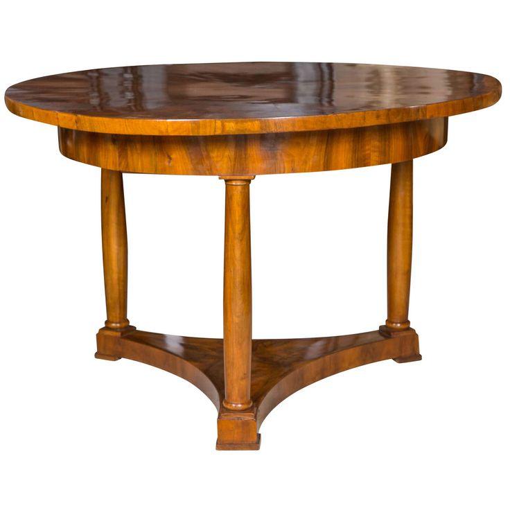 A Walnut Biedermeier Round Table On Three Shaped Columnar Legs With Beautiful Figured Wood