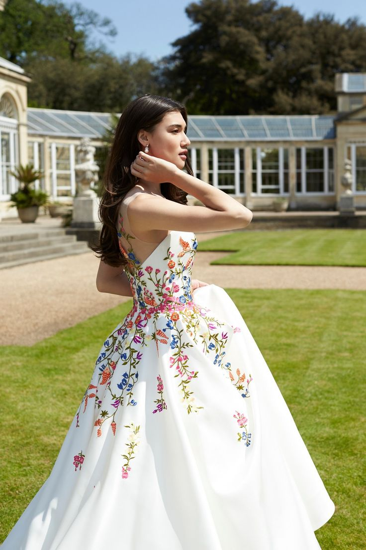 Beautiful colorful flowers with a white backdrop! The Twenty17 collection by Sassi Holford - British bridal fashion designer.