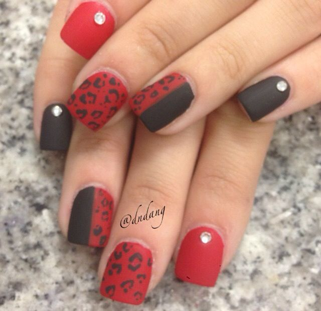 cute black and red cheetah nail design with studs!