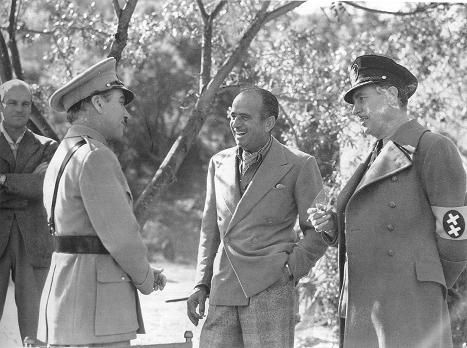 Visitor Douglas Fairbanks with director actor Charlie Chaplin & Reginald Gardiner on the set of The Great Dictator, 1940.