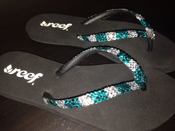 Team bling flip flops by RansdellsRhinestones on Etsy, $40.00  These fun, sparkly flip flops are made to order! Show your team spirit with a pair of custom made flip flops covered in your choice of colored rhinestones! These are great for gymnastic teams, cheerleading, softball, etc. These blingy flip flops are a fun way to stand out as a team, and differentiate you from all the others!  Please note that these are made to order. Please allow up to 7 business days to complete your order!!