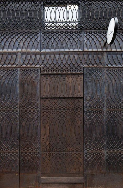 Bespoke cast iron panels. Albemarle Street store extension by Paul Smith with 6a Architects.