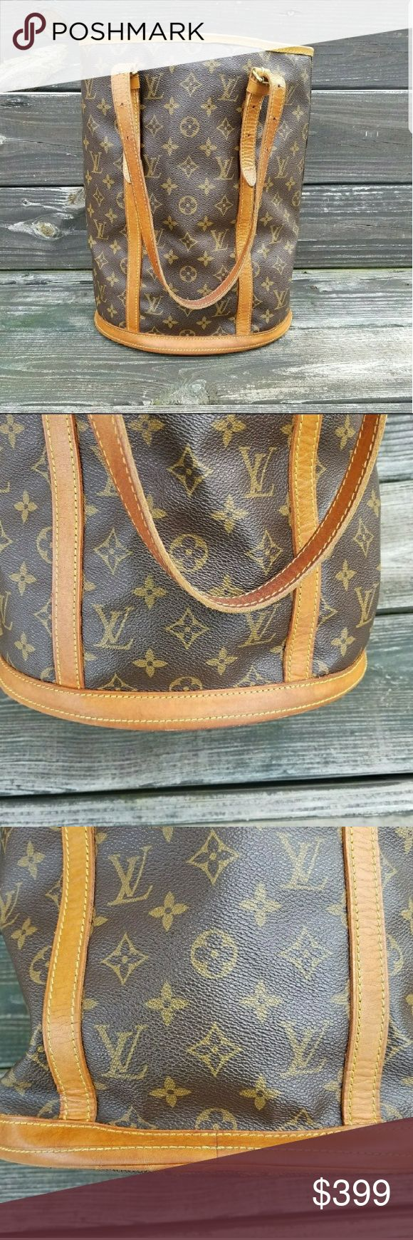 Louis Vuitton Bucket Bag 👜❤👜❤Authentic Louis Vuitton GM bucket bag.  Good used condition.  Leather has minimal staining and watermarks.  Leather straps show normal signs of wear for age of bag.  Vinyl is in great condition with no rips, cracks, tears or scuff marks.  Interior lining is like new.  No rips, tears, peeling, stains or stickiness.  This is a great classic bag with a lot of life left in it. Louis Vuitton Bags